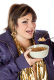 Pretty woman eating breakfast cereal Stock Photo