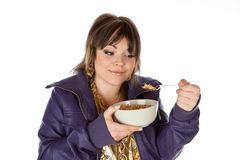 Pretty woman eating breakfast cereal Stock Photos