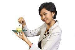 Pretty Woman Eating Cake with Fork Stock Photos