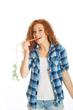 Pretty woman eating a carrot Stock Photo