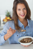 Pretty woman eating cereal Stock Images