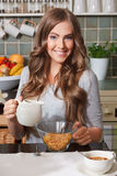 Pretty woman eating cornflakes Stock Photos
