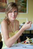 Pretty Woman Eating Dessert at Nice Restaurant Stock Photo