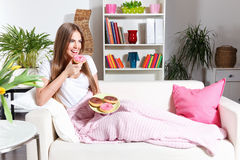 Pretty woman eating donuts Stock Image