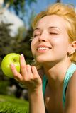 Pretty woman eating green apple Royalty Free Stock Images