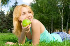 Pretty woman eating green apple Stock Photo