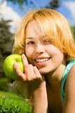 Pretty woman eating green apple Royalty Free Stock Photography