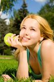 Pretty woman eating green apple Stock Images