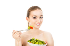Pretty woman eating salad isolated on white background. Pretty woman eating salad isolated Stock Photos