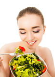 Pretty woman eating salad isolated on white background. Pretty woman eating salad isolated Stock Images