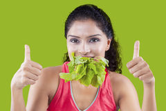Pretty woman eating spinach Royalty Free Stock Images