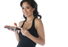 Pretty woman eating sushi Stock Photo