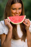 Pretty woman eating watermelon outdoor Stock Photo