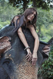 Pretty woman on the elephant. Pretty woman on the young elephant Stock Images