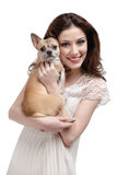 Pretty woman embraces a straw-colored dog Royalty Free Stock Photo