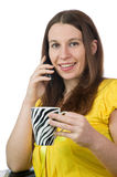 Pretty woman enjoying a beverage Royalty Free Stock Photos