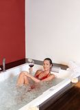 Pretty woman enjoying bubble bath Royalty Free Stock Photography