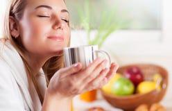 Pretty woman enjoying coffee Stock Image