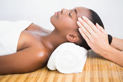 Pretty woman enjoying a head massage Royalty Free Stock Photography
