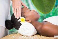 Pretty woman enjoying a head massage Royalty Free Stock Image