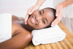Pretty woman enjoying a head massage Stock Photo