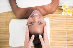 Pretty woman enjoying a head massage Stock Images