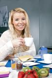 Pretty woman enjoying her breakfast Royalty Free Stock Images