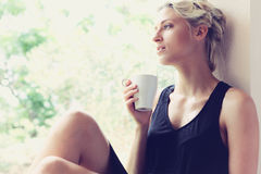 Pretty woman enjoying her morning coffee Stock Photography