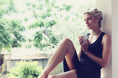 Pretty woman enjoying her morning coffee Stock Image