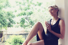 Pretty woman enjoying her morning coffee Royalty Free Stock Images