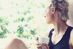 Pretty woman enjoying her morning coffee Stock Photo
