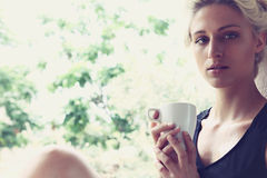 Pretty woman enjoying her morning coffee Royalty Free Stock Image