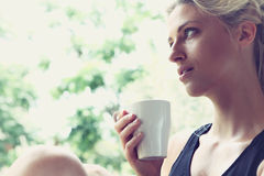 Pretty woman enjoying her morning coffee Royalty Free Stock Photos