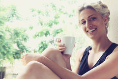 Pretty woman enjoying her morning coffee Stock Images