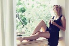 Pretty woman enjoying her morning coffee Royalty Free Stock Photo