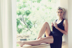 Pretty woman enjoying her morning coffee Stock Photos