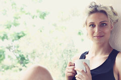 Pretty woman enjoying her morning coffee Royalty Free Stock Photos