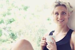 Pretty woman enjoying her morning coffee Royalty Free Stock Image