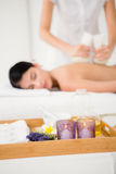 Pretty woman enjoying a herbal compress massage Royalty Free Stock Image