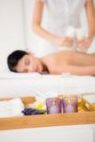 Pretty woman enjoying a herbal compress massage Royalty Free Stock Image