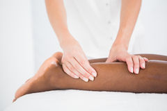 Pretty woman enjoying a leg massage Royalty Free Stock Photos