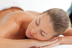 Pretty woman enjoying a massage Stock Photography