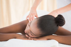 Pretty woman enjoying a massage Royalty Free Stock Photo