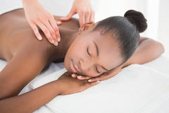 Pretty woman enjoying a massage Royalty Free Stock Image