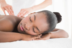 Pretty woman enjoying a massage. At the health spa stock image