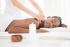 Pretty woman enjoying a massage Stock Image