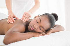Pretty woman enjoying a massage Stock Photos