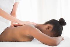 Pretty woman enjoying a massage Royalty Free Stock Image