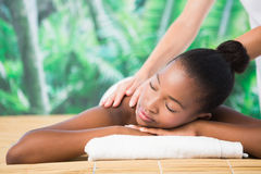 Pretty woman enjoying a massage Stock Image