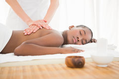 Pretty woman enjoying a massage Royalty Free Stock Photography